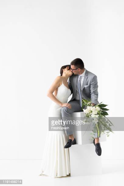 studio portrait of happy bride and groom - loafers stock pictures, royalty-free photos & images