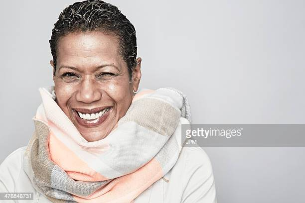 Studio portrait of happy mature woman