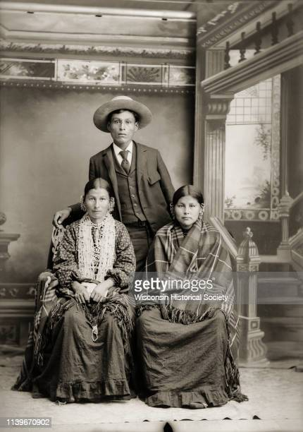 Studio portrait of HoChunk group from left to right the wife of George Lowe George Monegar and the sister of John Stacy who are posing in front of a...