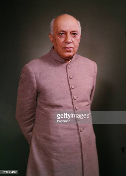 Studio portrait of Indian politician and India's first Prime Minister Jawaharlal Nehru as he stands with his hands behind his back early 1960s