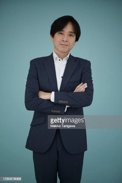 studio portrait of japanese man - double breasted stock pictures, royalty-free photos & images