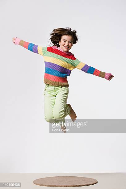Studio portrait of jumping girl (8-9)