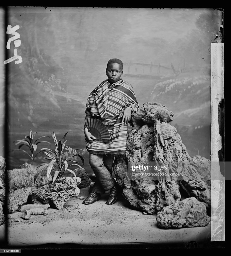 A studio portrait of Kalulu (Ndugu M'Hali, circa 1865 - 1877), 8th August 1872. Kalulu was the personal servant and adopted child of Sir Henry Morton Stanley and accompanied the British explorer and journalist on his travels in Europe, America and the Seychelles. He was killed during an expedition in central Africa when the canoe he was travelling in was taken over the fifth cataract at the Livingstone Falls on the Lualaba river. Following his death, Stanley renamed the waterfall 'Kalulu Falls' in his memory.