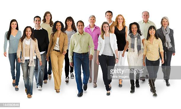 Studio portrait of large group of people walking  arm in arm