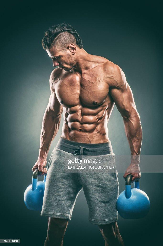 Studio portrait of male fitness athlete : Stock Photo