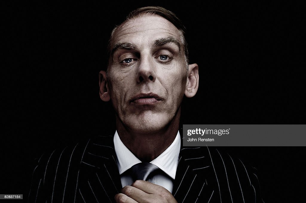 Studio portrait of man in suit : Stock Photo