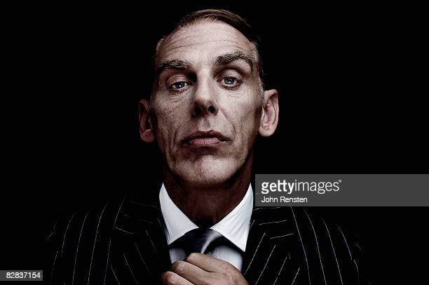 studio portrait of man in suit - stereotypically upper class stock pictures, royalty-free photos & images