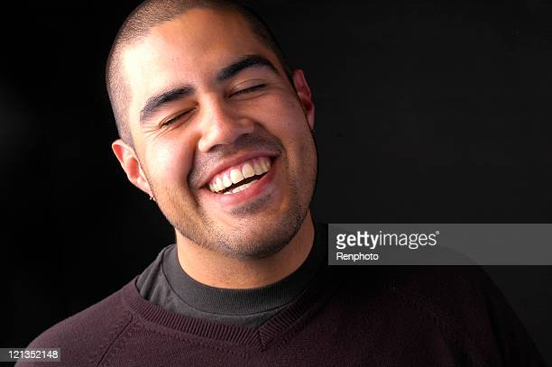 Studio Portrait of Man Laughing