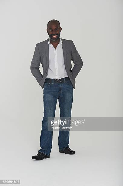 studio portrait of man - black trousers stock pictures, royalty-free photos & images