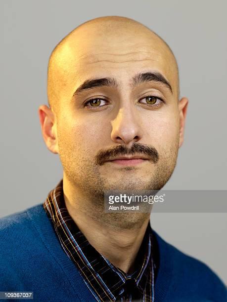 Studio portrait of man with moustache