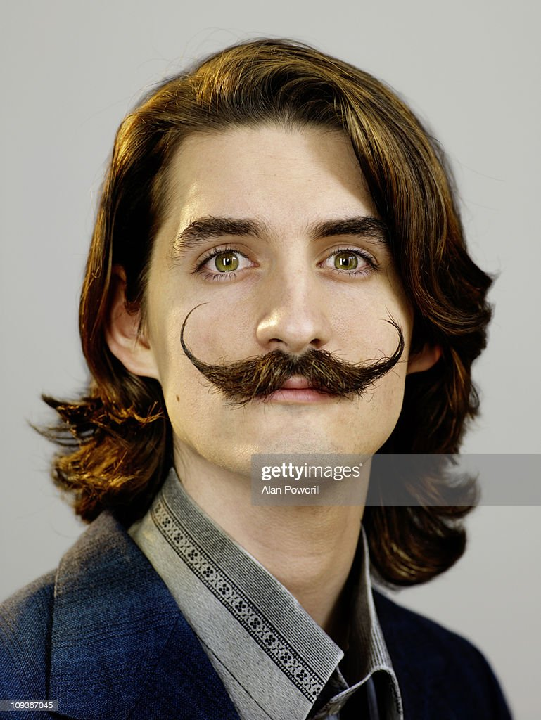 Studio portrait of man with moustache : Stock Photo