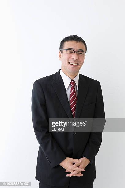 Studio portrait of mature businessman laughing