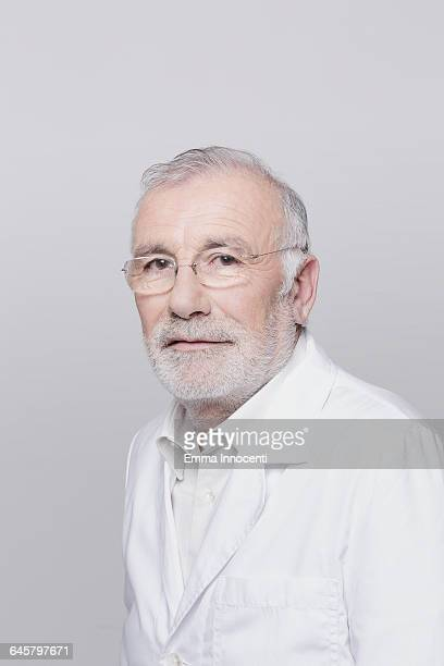 Studio portrait of mature doctor with spectacles