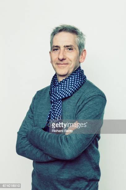 Studio portrait of mature gray haired man.