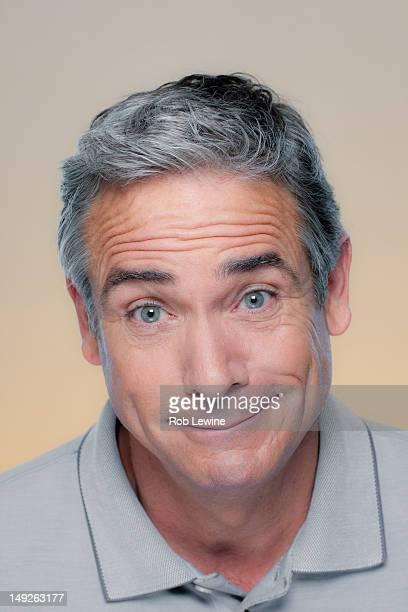 Studio Portrait of mature man smiling