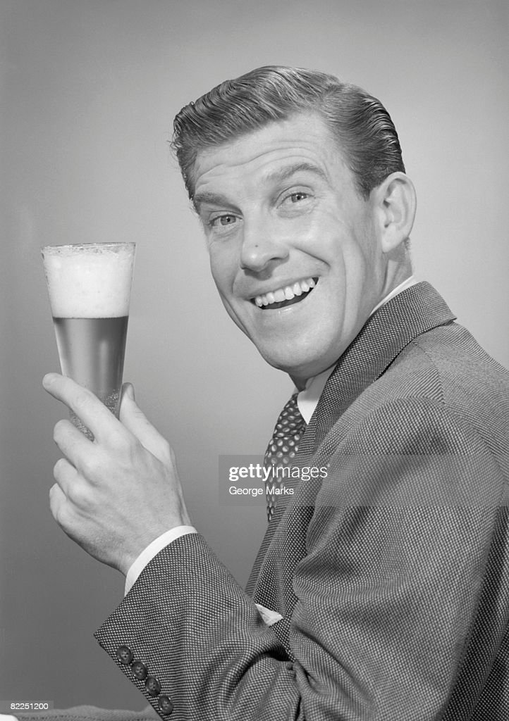 Studio portrait of mature man with glass of beer : Stock Photo