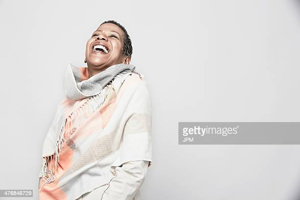 Studio portrait of mature woman laughing