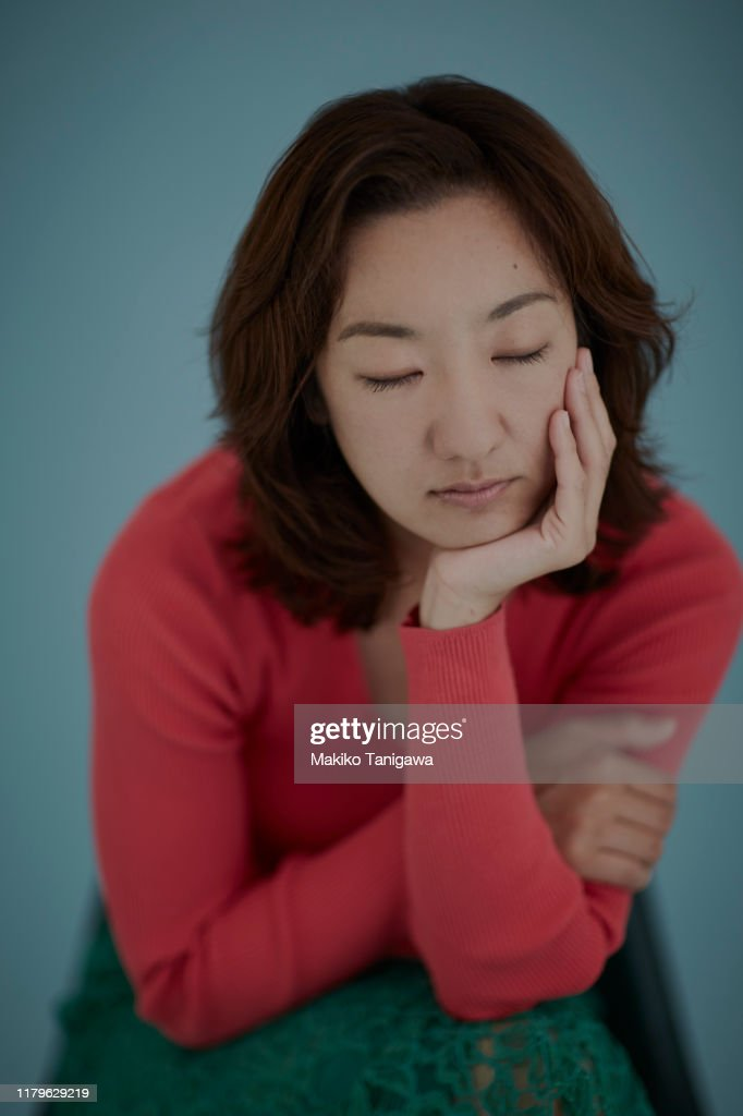 Studio portrait of mature woman : Stock Photo