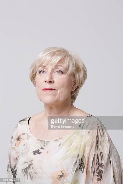 Studio portrait of mature woman smiling