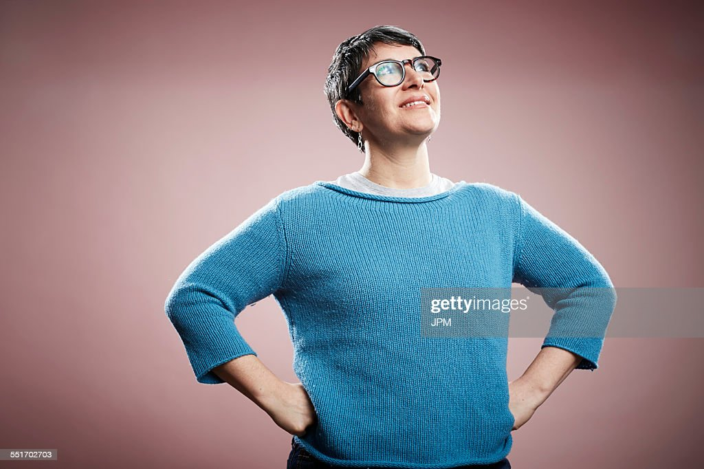Studio portrait of mature woman with hands on hips : Stock Photo