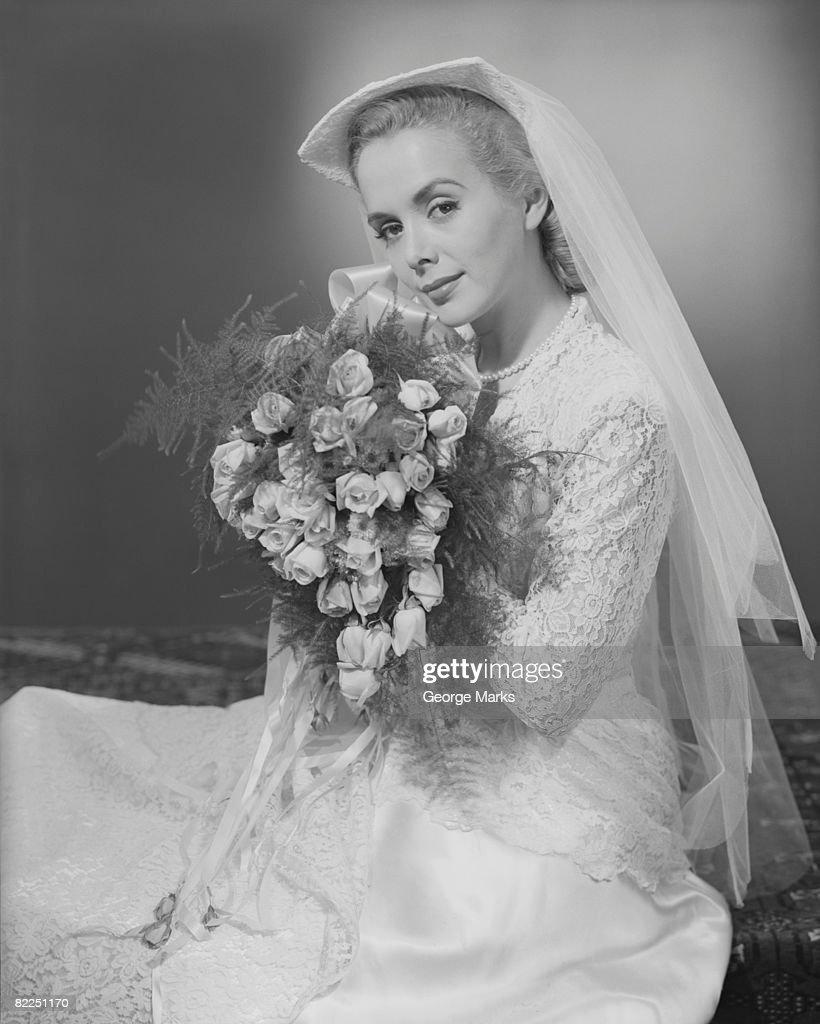 Studio portrait of mid adult bride : Stock Photo
