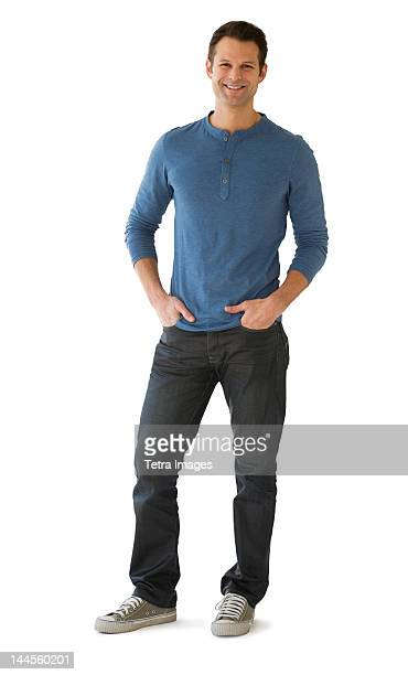 studio portrait of mid adult man - white pants stock pictures, royalty-free photos & images