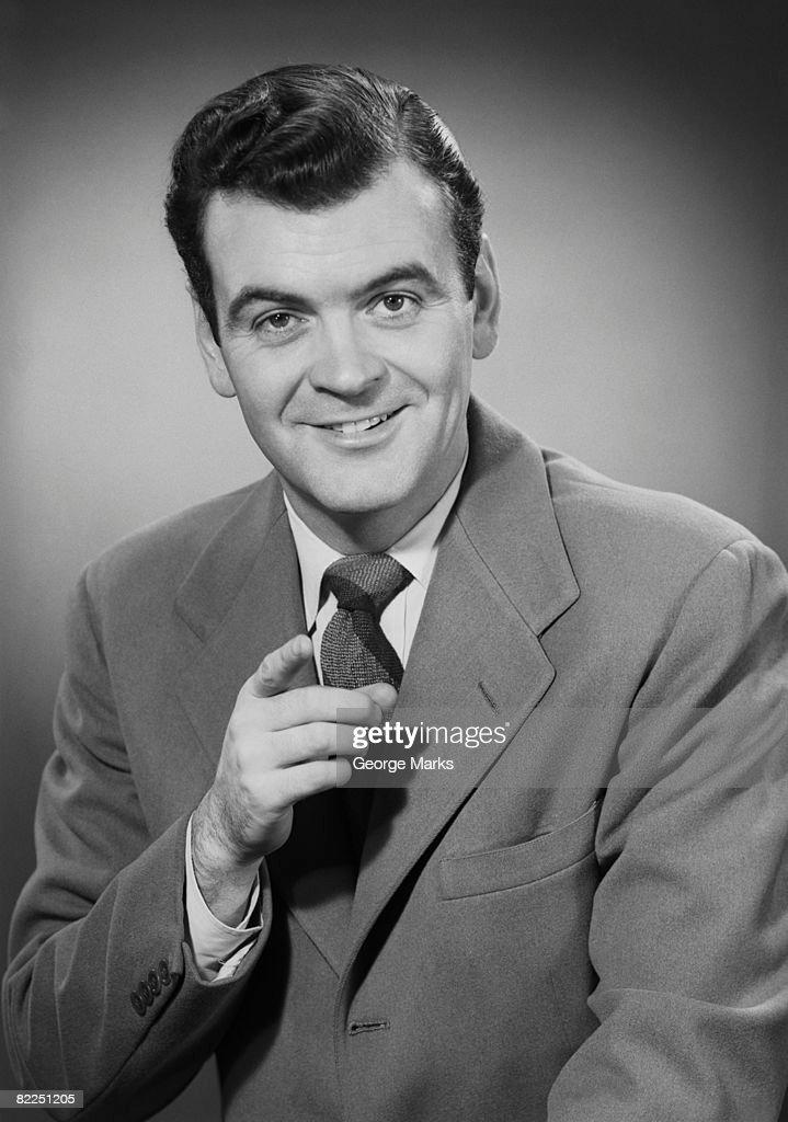 Studio portrait of mid adult man pointing : Stock Photo