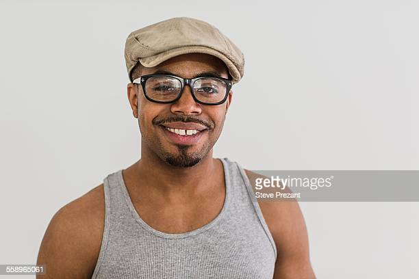 studio portrait of mid adult man wearing flat cap - flat cap stock pictures, royalty-free photos & images
