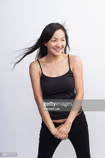 studio portrait of mid adult woman - black hair stock pictures, royalty-free photos & images