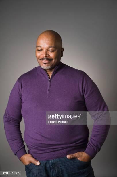 studio portrait of middle aged african american male - mani in tasca foto e immagini stock
