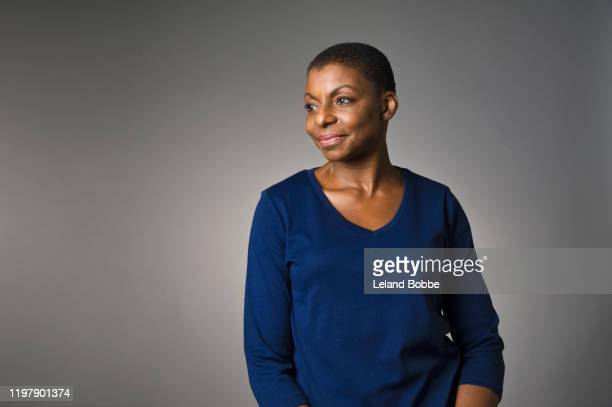 studio portrait of middle aged african american woman - looking away stock pictures, royalty-free photos & images