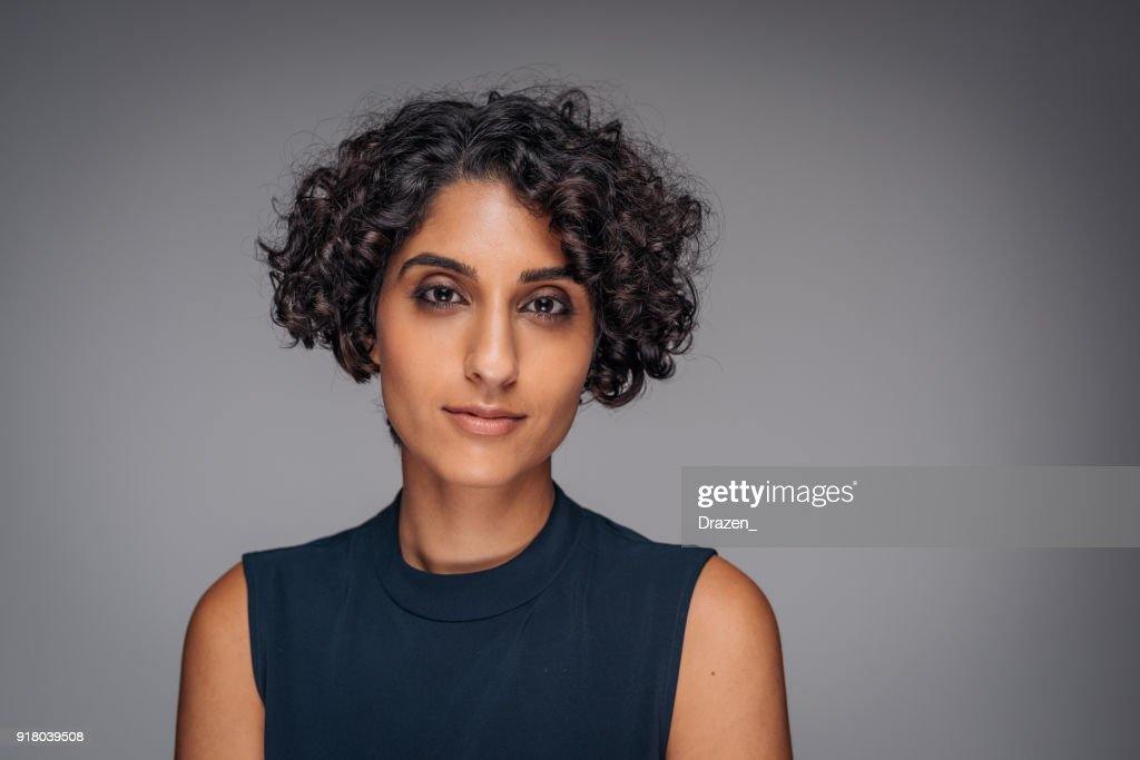 Studio portrait of Middle Eastern adult woman, showing sadness and grief : Stock Photo