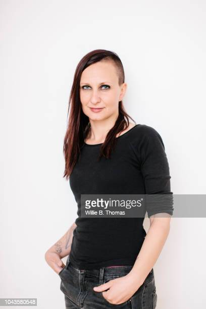 studio portrait of modern young woman - half shaved hairstyle stock pictures, royalty-free photos & images