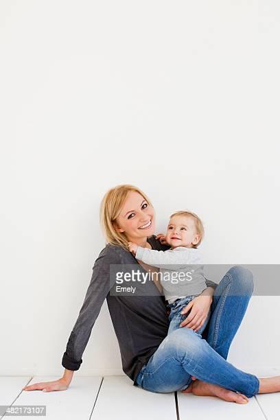 Studio portrait of mother and baby girl