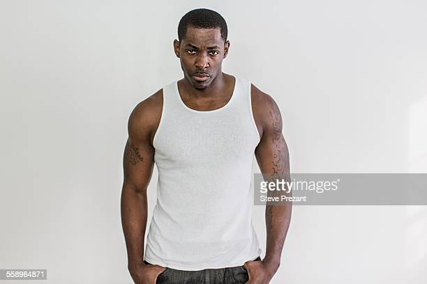 Studio portrait of muscular macho mid adult man