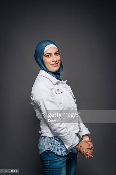 Studio portrait of Muslim adult woman with headscarf