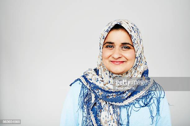 Studio portrait of muslim woman smiling to camera
