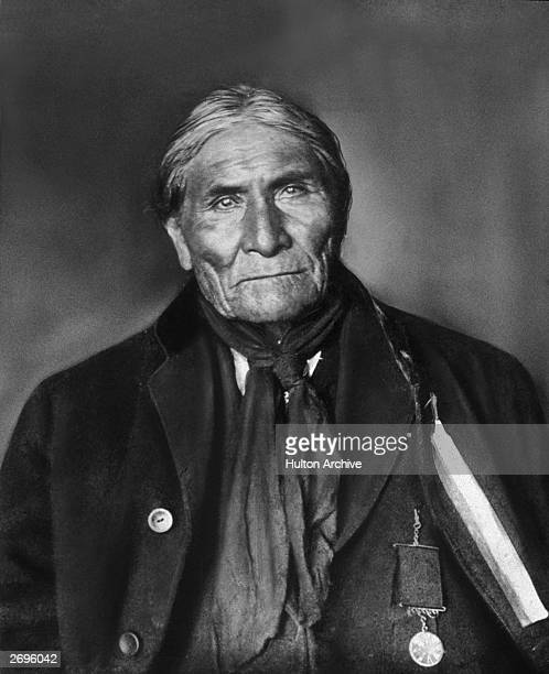 Studio portrait of Native American Apache Indian chief and warrior Geronimo wearing an honorary medallion and Western clothes