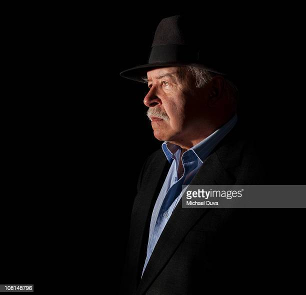 studio portrait of older man on a black background - moustache stock pictures, royalty-free photos & images