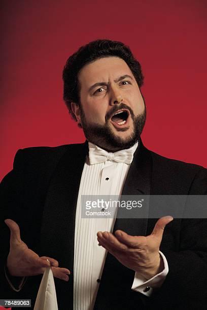 Studio portrait of opera singer singing