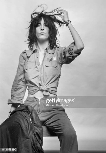 Studio portrait of Patti Smith wearing a US air force shirt Amsterdam Netherlands 9th October 1976