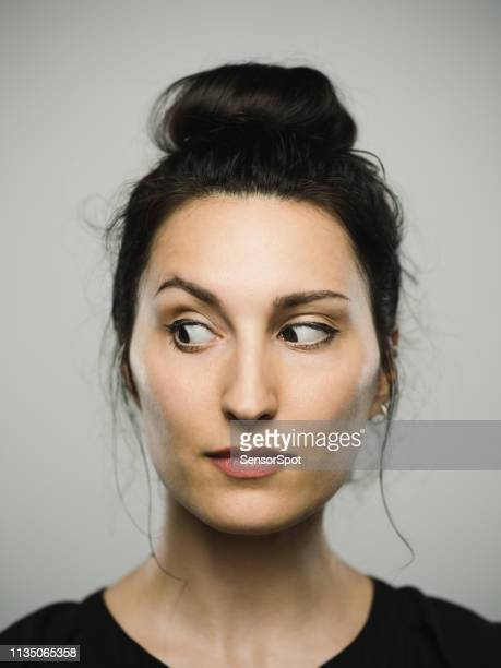studio portrait of real mediterranean young woman looking to the side - curiosity stock pictures, royalty-free photos & images