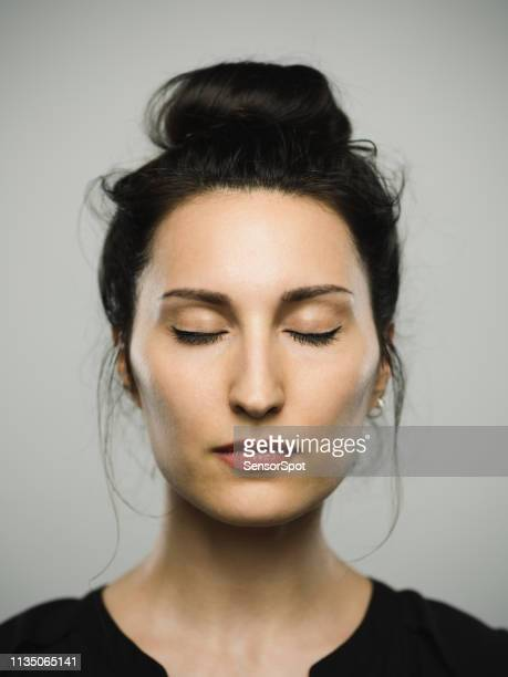 studio portrait of real mediterranean young woman with eyes closed - eyes closed stock pictures, royalty-free photos & images