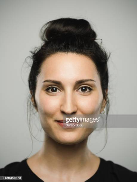 studio portrait of real mediterranean young woman with happy expression - southern european descent stock pictures, royalty-free photos & images