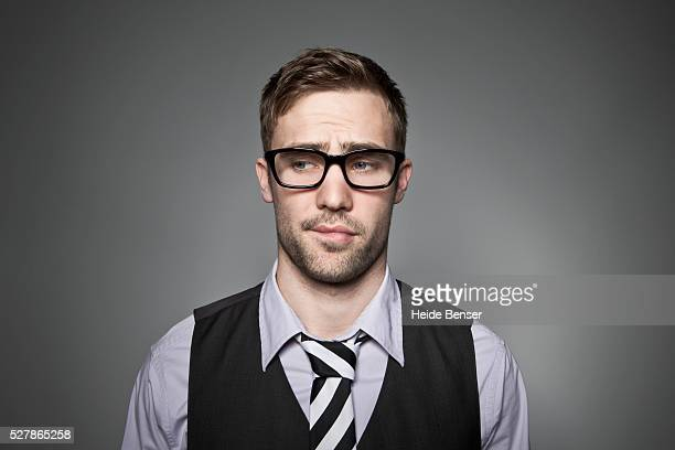 studio portrait of sad business man - biting lip stock pictures, royalty-free photos & images