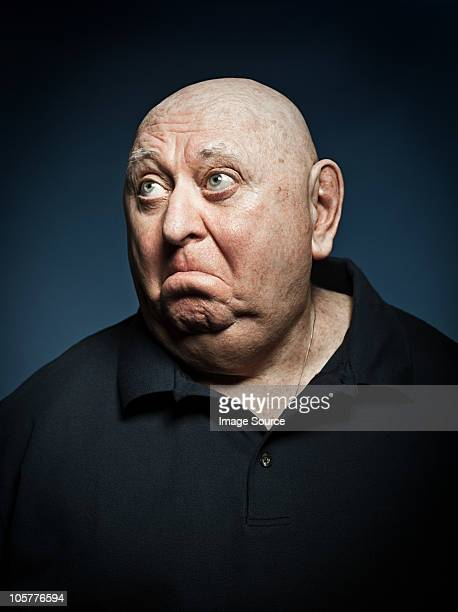 studio portrait of sad senior man - fat black man stock photos and pictures