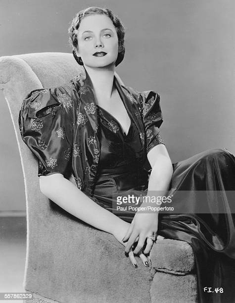 Studio portrait of Scottish actress Frieda Inescort pictured sitting in an armchair for Warner Bros and Vitaphone Pictures circa 1940