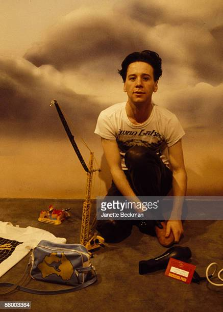 Studio portrait of Scottish singer and musician Jim Kerr from the band Simple Minds Coventry England 1981 He poses in front of a dramatic skyscape...