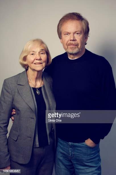 Studio portrait of senior couple, arm in arm