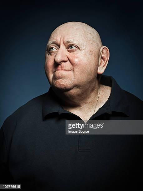 studio portrait of senior man - fat bald men stock pictures, royalty-free photos & images
